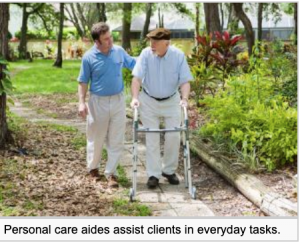 Home Health Aide worker walks an older man with a walker in a park