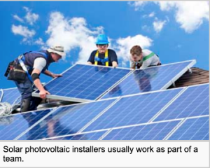 Career solar installers are working on a roof professionally installing solar panels
