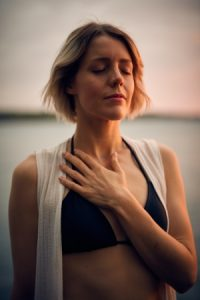 woman with closed eyes meditates